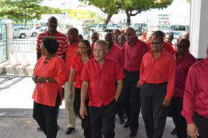 Opposition Leader Owen Arthur, leads the party's candidates into the Treasury Building to make their deposits.