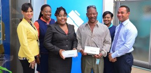 From left, Sharon Zephirin, Retail Services Manager Broad Street Branch; Tonya Morris Sales Officer; prize winners Laticlea White and Michael Williams, Lianne Howard Communications Assistant and Adam Waterman Retail Services Manager.