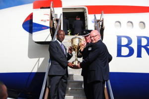 Minister of Sports Stephen Lashley, general manager of Sandy Lane Randall Wilkie and British Airways' captain Peter Brown posing with the Gold Cup.