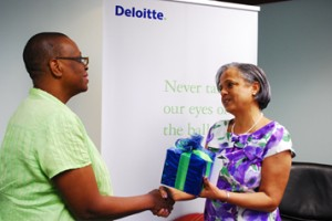 Betty Brathwaite, Deloitte Partner makes a presentation to Paige Bryan, President of the YWCA.