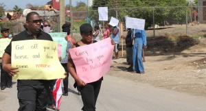 Attorney Gregory Nicholls (left) leads residents in protest.