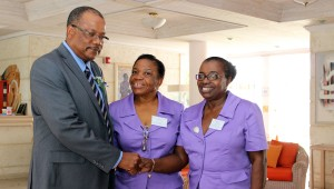 Minister of Health, John Boyce speaking with Assistant Secretary of the BECA, Jenise Belgrave and President of the BECA, Maureen Ward.