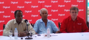 The Barbados Tourism Authority's Gregory Armstrong (l) makes a point while to his left is Sir Garfield Sobers and Digicel's Dennis O'brien.