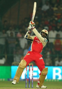 Chris Gayle launches a six during his unbeaten innings.