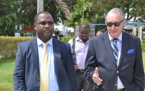 Inniss and Sir David start tour of rum distillery and distribution warehouse at Foursquare.