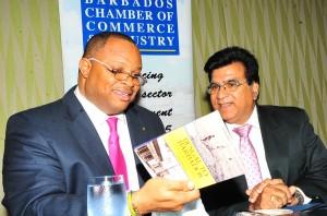 Minister of Finance Chris Sinckler (left) and BCCI president Lalu Vashwani at today's meeting.