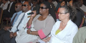 President of the Barbados Council for the Disabled and the Senate Kerryann Ifill (second right) speaking at the launch this morning. Next to her is Roger Vaughn (left) and Roseanne Tudor (right).