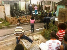 Police, onlookers at the scene of the blaze.