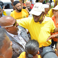 Jack Warner is surrounded by supporters yesterday at the launch of his re-election campaign for the Chaguanas West constituency at the Caroni Bird Sanctuary.