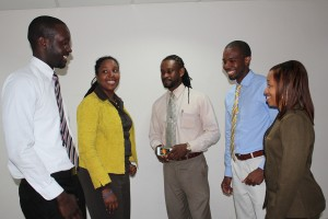 From left: Ramon Jordan, LIME's Carolyn Williams- Gayle, MQI's Pedro Callender, Elevate's Mario Greene, and Signia's Samantha Inniss chatting after the launch.