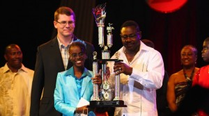 8-12 Junior Calypso Monarch, Johari Taitt, in 2009 accepting her trophy from then Minister of Culture, Steve Blackett.