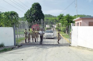 Students seen behind the gates of Anchovy High School in St James yesterday.