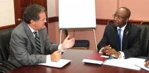 Minister of Culture, Sports and Youth, Stephen Lashley (right) listens to Canadian High Commissioner to Barbados, Richard Hanley.