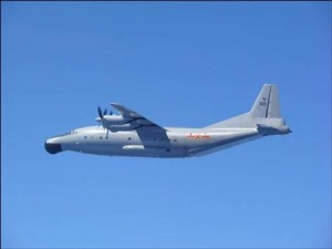 A Chinese military plane Y-8 airborne early warning plane flies through airspace between Okinawa prefecture's main island and the smaller Miyako island in southern Japan out over the Pacific, in this handout photo