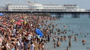 Residents of the UK flock to the beach to try to beat the heat.
