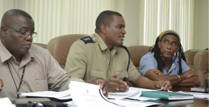 From left: Assistant Superintendent Bruce Rowe, Acting Assistant Commissioner, Erwin Boyce and NCF's Aja.