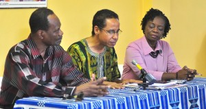 Chairman of September Third Foundation, David Comissiong (centre) addresses members of the Press, while Richard Stoute (left) and Doriel Skinner (right) look on.