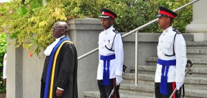 Chief Justice Sir Marston GIbson oversees ceremony at Supreme Court Complex accompanied by Acting Commissioner of Police Tyrone Griffith and the commissioner's Staff Officer Inspector Ian Branch.