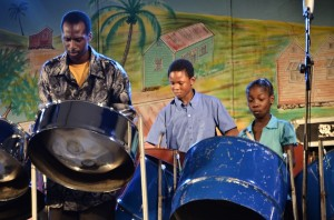 Members of the SKF Eden Lodge Steel Pan Orchestra performing at the launch of the Community Independence