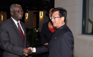 Chinese Ambassador to Barbados, Xu Hong, welcomes Prime Minister Freundel Stuart to the reception at Hilton Barbados to mark the 64th anniversary of the founding of the People's Republic of China.