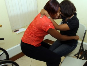 Physio-therapist, Nicola Yarde (left) demonstrates how a disabled person can be lifted from a chair without injuring yourself.
