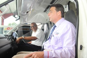 Toyota managing director Roger Hill checking out one of the new ambulances.