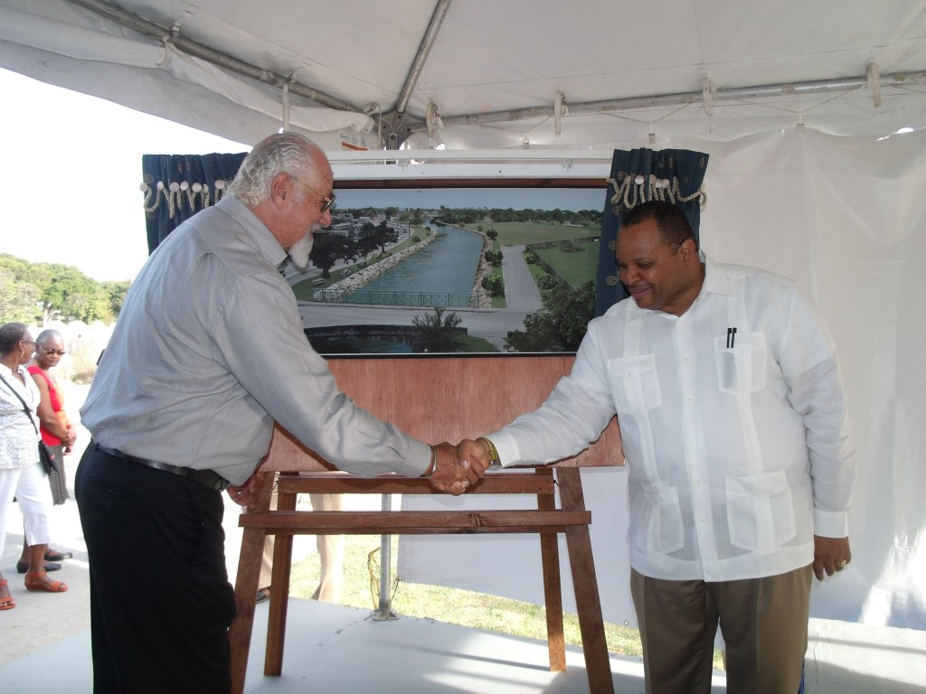 Chairman of the Barbados Tourism Investment Inc, Andrew Marishow (L) shakes hands with Minister of  Finance, Chris Sinckler.
