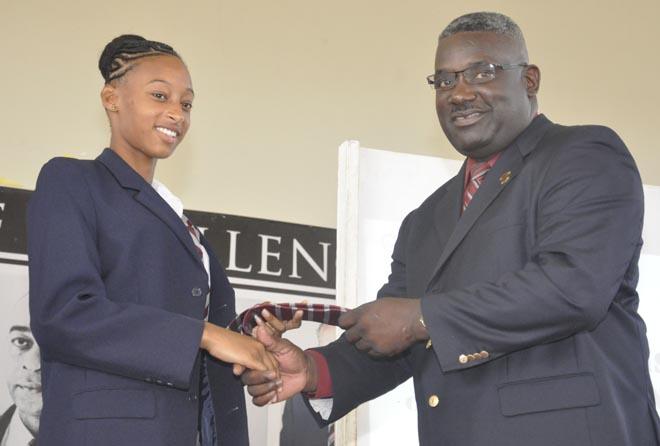 Headmaster Vincent Fergusson congratulating Sada Williams.