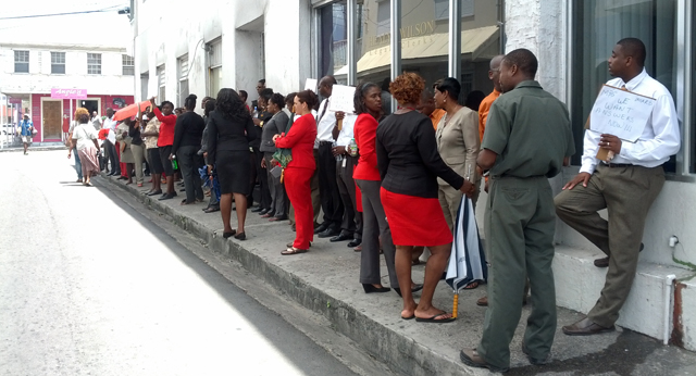 Over 70 placard-bearing line staff and supervisors:confidential workers from MBS took protest action to the doorstep of the Ministry of Labour.