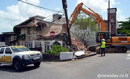 This derelict house on Court Street, San Fernando, was demolished yesterday by the San Fernando City Corporation.