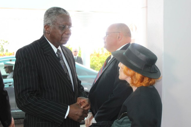 Prime Minister Freundel Stuart (left) expressing his sympathy to Sir Denys' widow Lady Carmel Williams. In the background is Sir Denys' son Shaun.
