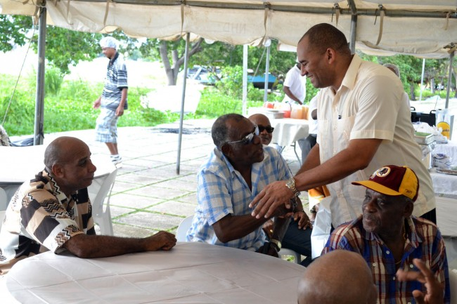 Acting Prime Minister Richard Sealy greeting people at the Seafarer's Day event at the Bay Street Esplanade. Inset, Minister  of Housing  Denis Kellman.