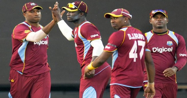 Kieron Pollard (left) and former captain Dwayne Bravo (second from right) have been excluded from the World Cup squad.