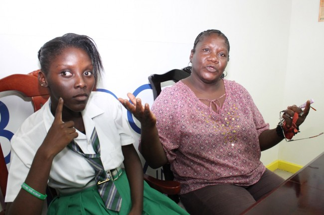 Cheryl Chandler (right) is calling on the Ministry of Education to provide an interpreter to sign to her daughter Nikita, a student at the St George Secondary School.