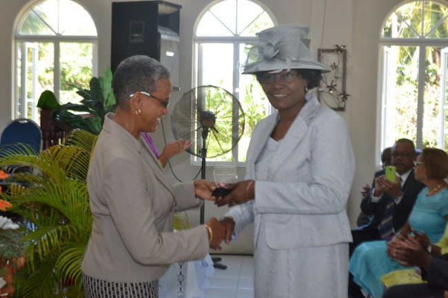 Margaret Marshall receives her award from from the MP.