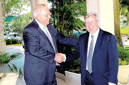 """Chairman of CIBC FirstCaribbean International Bank, Michael Mansoor (left) warmly welcomes new CEO, Douglas """"Rik"""" Parkhill to Regional Head Office, Barbados on his first day in office."""