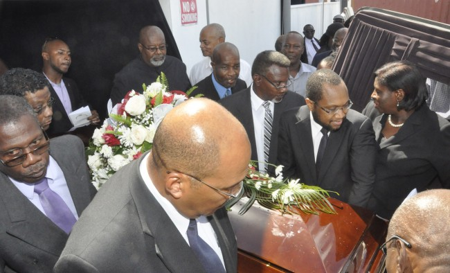 Roy's former Government Information Service colleagues wheeled the casket out of the Bajan Culture Village.