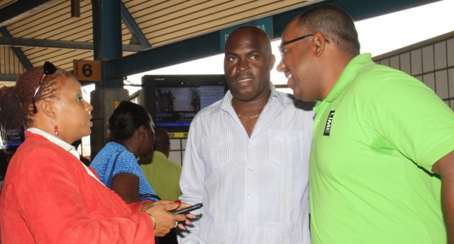 Minister Of Transport & Works Michael Lashley (second from right) discussing the refurbishment with LIME's CFO, Patrick Hinkson (right) and Transport Board's Lynda Holder and Ministry Admin Officer, Sophia Carter (left).