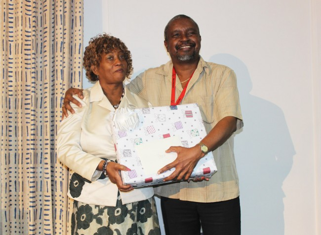 Dr Kenneth George (right) presenting his colleague and friend Angela Crawford with her gift.