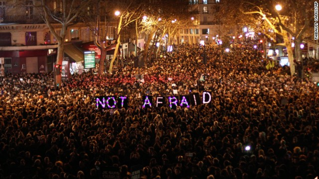 People gather in Paris last night in solidarity following the attacks.