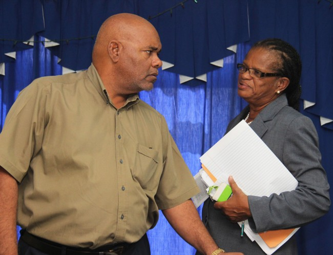 The National Union of Public Workers (NUPW) has put Government on notice that it will call out members soon to join retrenched National Conservation Commission employees in protest against the long wait for justice before the Employment Rights Tribunal. Acting General Secretary Roslyn Smith (right) listens attentively to member of the NUPW National Council Danny Gill after meeting with just over two dozen former NCC workers at the union's headquarters this morning.