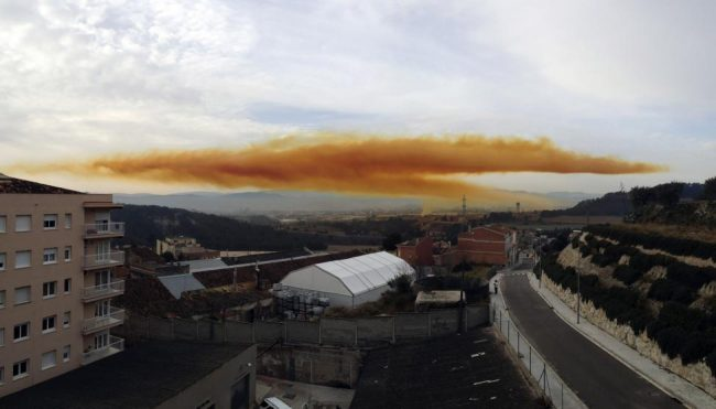 An orange toxic cloud is seen over the town of Igualada, near Barcelona, following an explosion in a chemical plant.