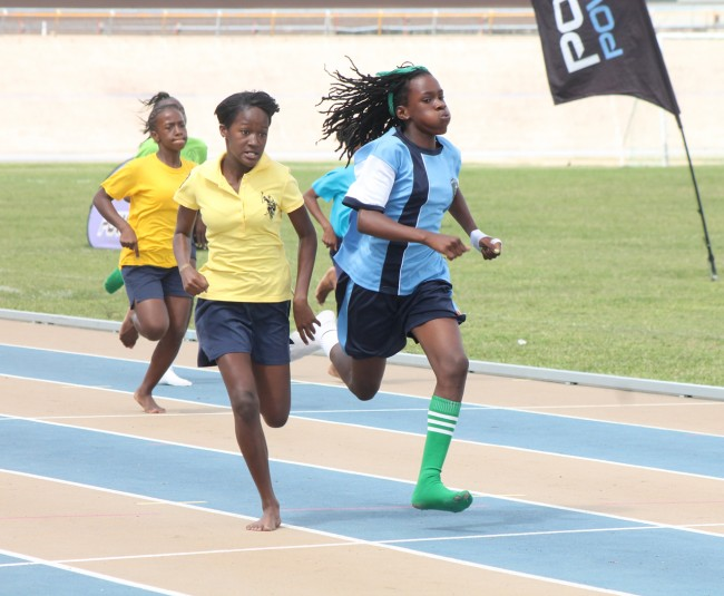 Junior victrix ludorum Dymond Holder of Lyson House won ahead of Kanisha Williams of O'Neal House in the 200m under-13 girls division.