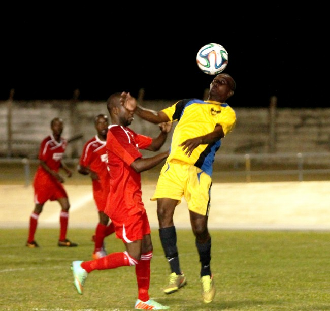 University of the West Indies goal scorer Corey Barrow heads the ball away during the match against Silver Sands FC.