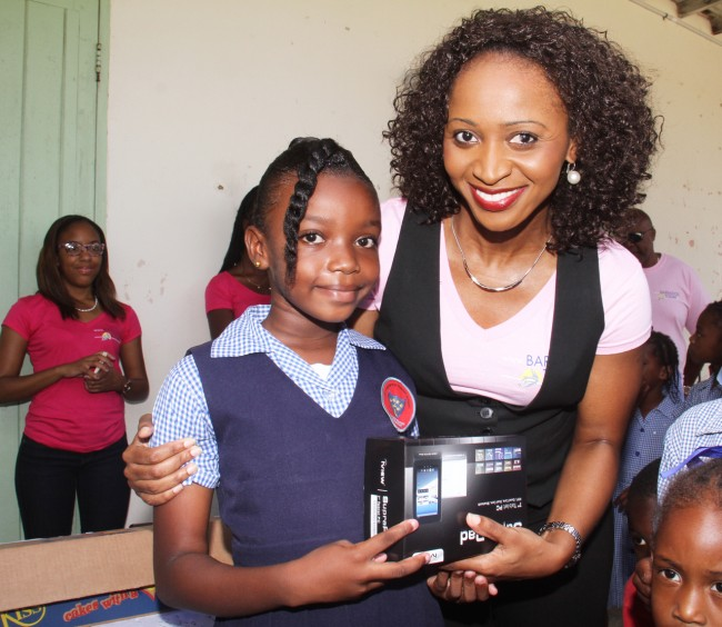 Nine-year-old Tamaya Francis of Class Two won herself a tablet, compliments of Promotech.