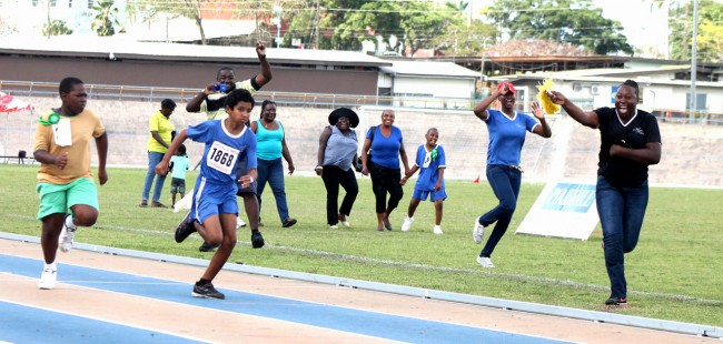 Christian Callender (in blue) of Early Sunshine Stimulation Center had big support on the sidelines when he won the boys 100m in the 8-11 category.