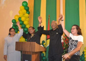 Prime ministerial candidate Moses Nagamootoo (left), joined by his wife and presidential candidate David Granger and his wife (right),  as they danced to Bob Marley's One Love anthem.