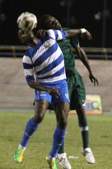 Rendezvous' striker Shandel Samuel did not score but was busy defending throughout the game. Here he heads the ball away into safety.