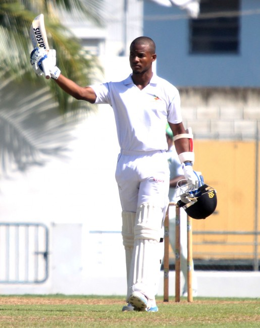 Shai Hope raises his bat on reaching his second century for Barbados today.