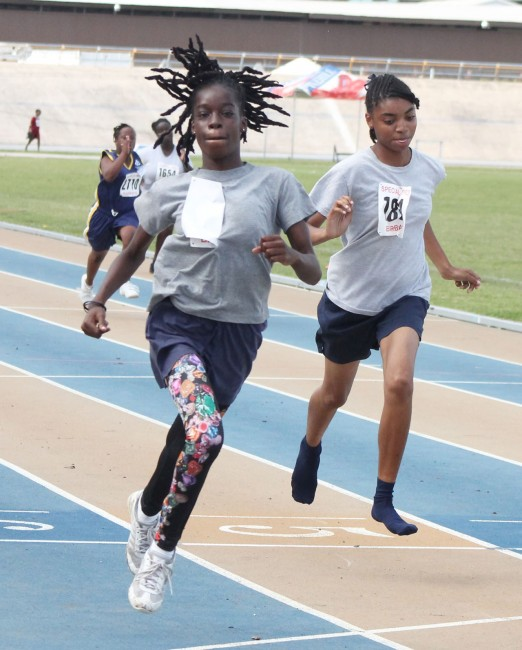 Sharnara Cain of Ann Hill (left) won the girls 100m in the 16 to 21 showdown.